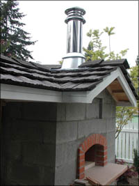 Finished roof and chimney assembly
