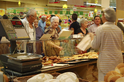 Italians queueing at the bakery counter of a Coop store