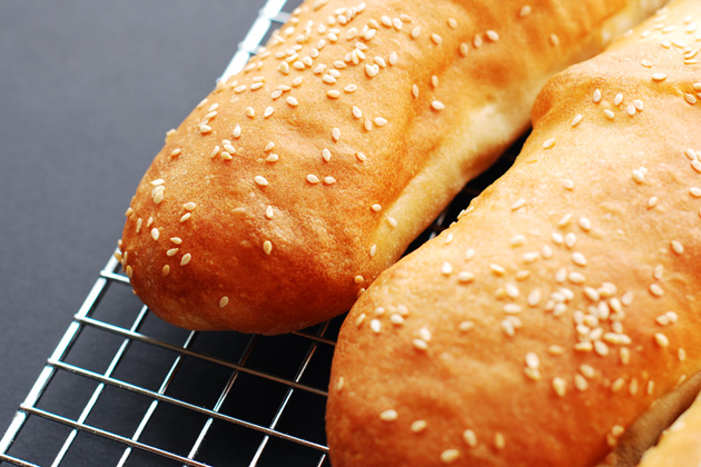 Sesame Seeded Sandwich Rolls cooling on a rack